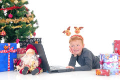 Child on laptop, xmas three Royalty Free Stock Photography