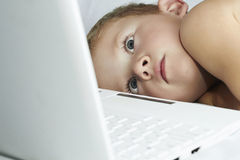 Child with laptop. 4 years old boy watching computer Stock Photography