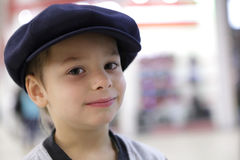 Child in large cap Royalty Free Stock Images