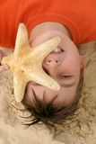Child with a large starfish Royalty Free Stock Images