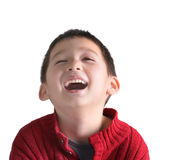 A happy child boy is laughing. With his eyes closed and his mouth open, he is wearing a red sweater, isolated on white background Stock Photo