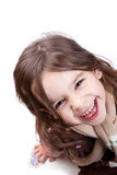 Child laughing. Beautiful child laughing spontaneously and looking up isolated on white background - 8 years old, vertical studio shot Royalty Free Stock Photo