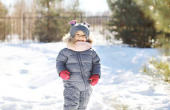 Child laughing and having fun in winter day Royalty Free Stock Photography