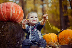 A child laughs - is preparing for Halloween. Royalty Free Stock Image