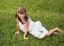 Child on the lawn Royalty Free Stock Photo