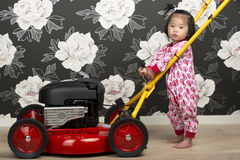 Child and lawn mower Royalty Free Stock Image