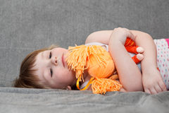 Child layig on sofa Stock Images