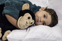 Child Laying in Bed Stock Images