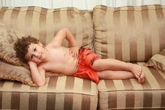 Child laying on sofa Royalty Free Stock Images