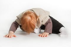 Child Laying On White Floor Stock Photos