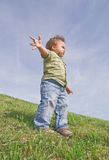 Child leader. Toddler standing on a hill, view from below stock images