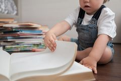 The child leafs through the book. royalty free stock photography