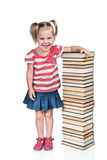 Child leaned against a pile of books Royalty Free Stock Images