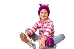 Child leaning ice skating Stock Photo