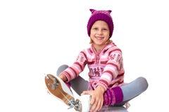 Child leaning ice skating Stock Photo