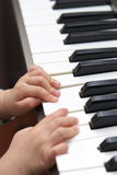 Child learn piano Royalty Free Stock Photo