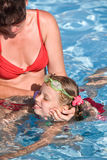 Child learn swim in swimming pool. Stock Photography