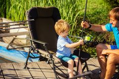 Child learn to fish on summer vacation stock photo