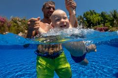 Child learn to swim. royalty free stock photography