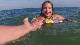 Child learn to swim stock footage