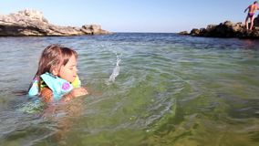 Child learn to swim stock video footage