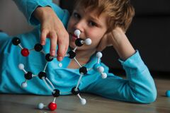 Child learning chemistry, building benzene ring, engineering and STEM
