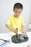A child  learning Chinese Calligraphy Royalty Free Stock Photos