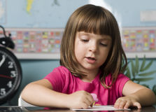 Child learning in classroom Royalty Free Stock Images
