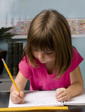 Child learning in classroom Stock Photo