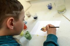 Child learning enamel art royalty free stock photography