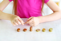 Child learning how to count money Stock Photos