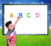Child are learning Index on a nature background. Royalty Free Stock Images