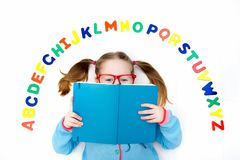 Free Child Learning Letters Of Alphabet And Reading Stock Photos - 121820703