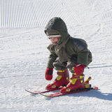 Child learning skiing. Small child learning to ski on a skiing slope stock photos