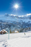 Child learning skiing in Swiss Alps - Klewenalp ski resort during a beautiful sunny day Stock Image