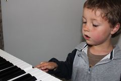 Child Learning to Play Piano Royalty Free Stock Photos