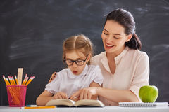 Child is learning to read. Back to school and happy time! Child is learning to read. Adult women teaches child the reading royalty free stock image