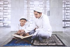 Child learning to read the Quran with father Royalty Free Stock Photography