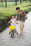 Child Learning to Ride Royalty Free Stock Photo