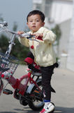 Child learning to ride. A baby learns to ride a new bicycle Royalty Free Stock Photography