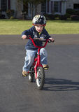 Child learning to ride bike Royalty Free Stock Photos