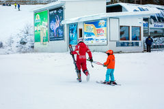 The child learning to ski and instructor Stock Photography