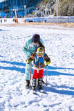 The child learning to ski with mother on the slope in Bansko, Bulgaria Stock Photo