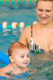Child learning to swim. In pool Royalty Free Stock Images