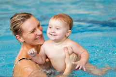 Child learning to swim Stock Photo