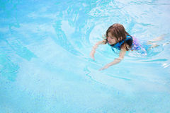Child learning to swim Stock Images