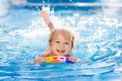 Free Child Learning To Swim. Kids In Swimming Pool Stock Image - 138993881
