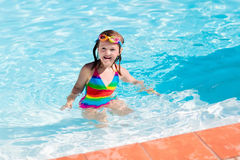 Child learning to swim in pool Royalty Free Stock Images