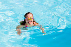 Child learning to swim in pool Stock Photo