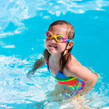 Child learning to swim in pool Royalty Free Stock Image